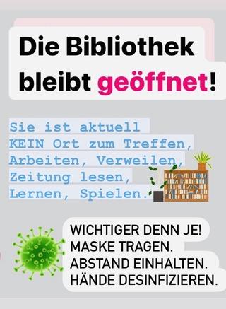Auf dem Bild steht gross: die Bibliothek bleibt offen
